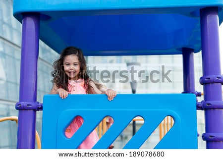 Adorable girl playing on the playground - stock photo