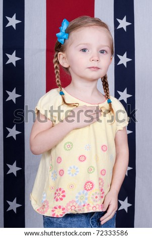 Adorable girl pledging alegiance in front of a patriotic design.