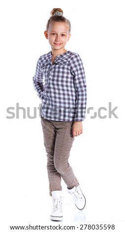 Adorable girl posing looking at camera. Isolated on the white background - stock photo