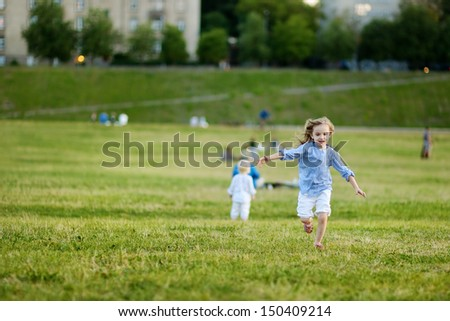 Adorable girl running around outdoors at summer - stock photo