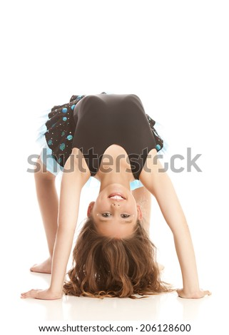 Adorable girl wearing her dance costume and performing a back bend.  Isolated on white with room for your text.