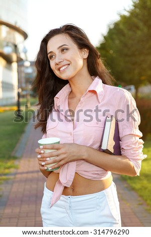 Adorable girl with cup of tea outdoors - stock photo
