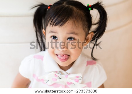 Adorable girl with funny face expression