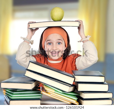 Adorable girl with many book in the school studying - stock photo
