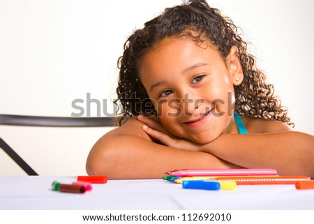 adorable girl writing at her desk - stock photo