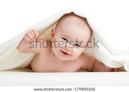 Adorable happy baby in towel - stock photo