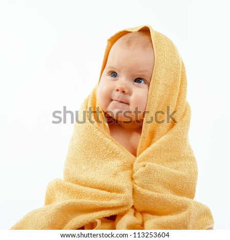 Adorable happy baby in yellow towel - stock photo