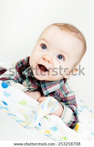 Adorable happy baby with blue eyes. studio photo - stock photo