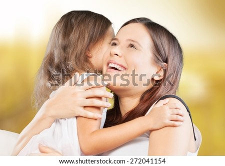 Adorable. Happy cheerful family. Mother and baby kissing, laughing and hugging - stock photo