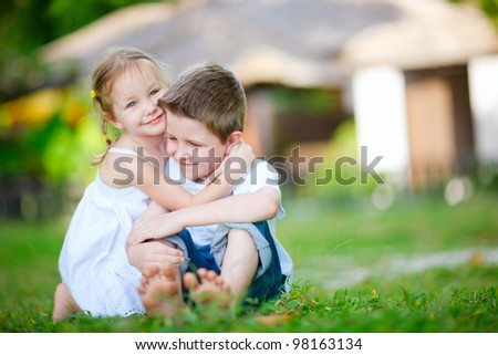 Adorable happy kids outdoors on summer day - stock photo