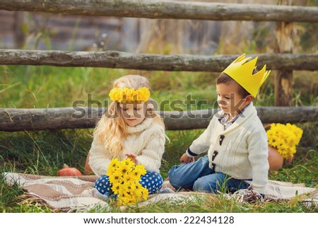 Adorable happy kids outdoors on sunny day in beautiful yellow autumn garden - stock photo