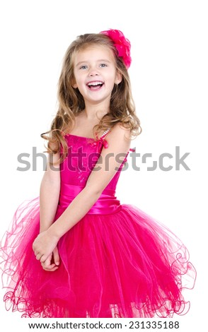 Adorable happy little girl in princess dress isolated on a white background
