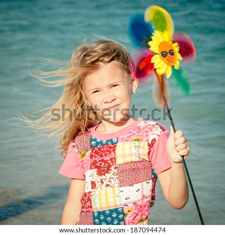 Adorable happy smiling girl on beach vacation - stock photo