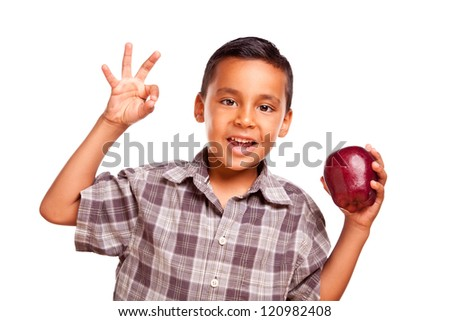 Adorable Hispanic Boy with Apple and Okay Hand Sign Isolated on a White Background. - stock photo