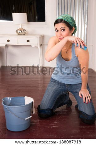 Adorable Housewife Doing Cleaning Chores Scrubbing Wood Floor Hands Knees