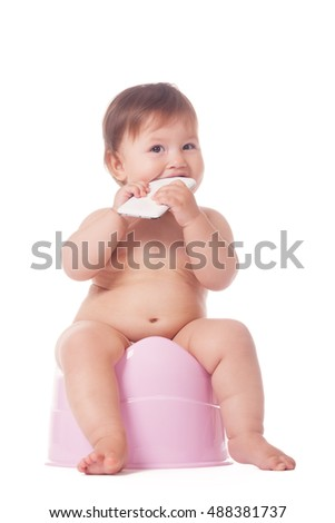 Adorable kid biting smartphone during potty training on isolated white