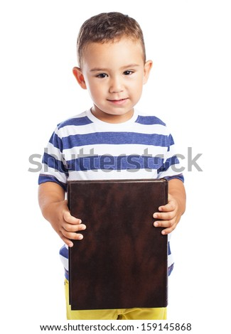 adorable kid holding a book isolated on white - stock photo