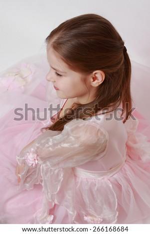 Adorable kid wearing pink dress as a princess - stock photo