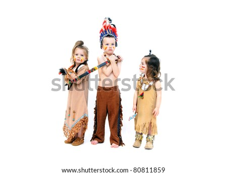 Adorable kids dress up for Halloween in indian costumes.  They are ready for war with their weapons and fierce expressions.