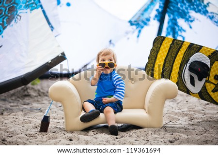 Adorable kiteboarder boy in the chair - stock photo