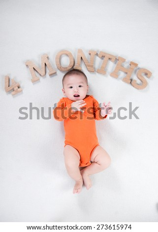Adorable laughing baby boy showing his first teeth - stock photo