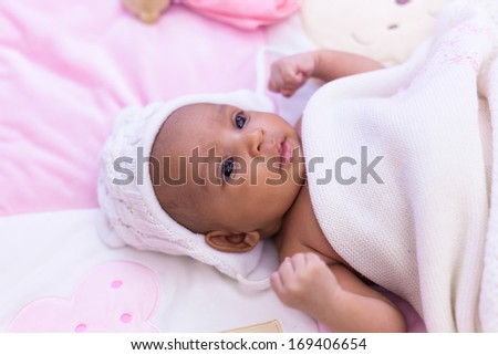Adorable little african american baby girl looking - Black people - stock photo