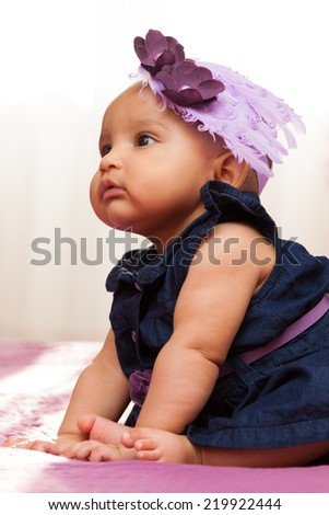 Adorable little african american baby girl looking - Black people