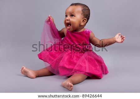 Adorable little african american baby girl  sitting on the floor - stock photo