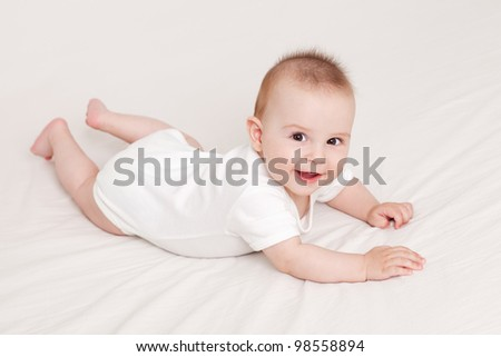 Adorable little baby crawling, on white background - stock photo