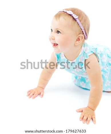 Adorable little baby girl laughing, crawling and playing at studio, isolated on white background, wearing stylish head decor, happy childhood concept