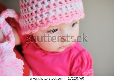 Adorable little baby girl sitting on the floor studio shot lovely portrait - stock photo