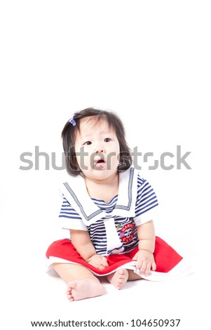 Adorable little baby girl , sitting & playing in the studio, isolated on towel