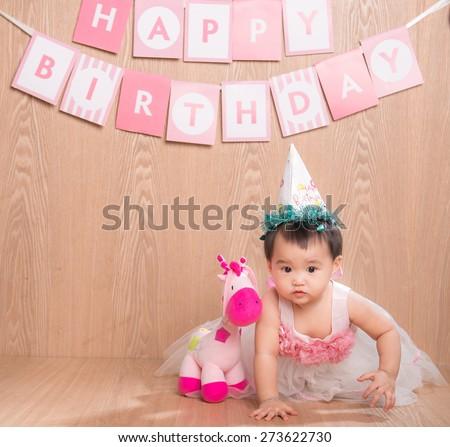 Adorable little baby girl smiling, sitting on the floor, studio shot, isolated on white background, lovely baby portrait - stock photo