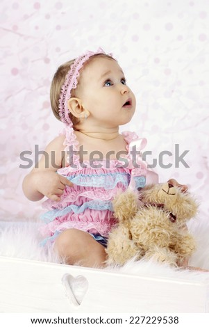 Adorable little baby with plush teddy bear - stock photo