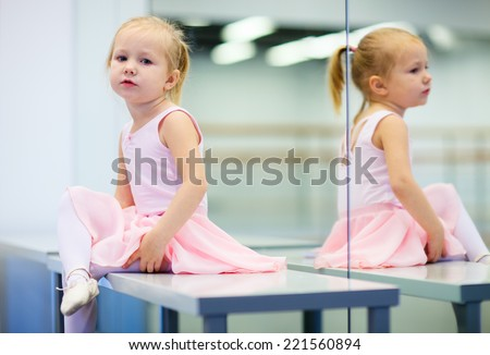 Adorable little ballerina wearing pink leotard in dancing school - stock photo