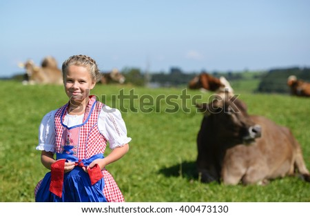 Adorable little  bavarian girl on a country field  during Oktoberfest in Germany - stock photo