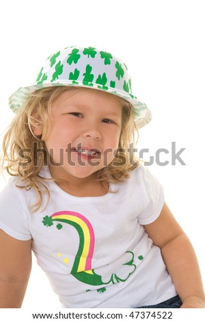 Adorable little blond girl smiling wearing St. Patrick's day hat and t shirt - stock photo