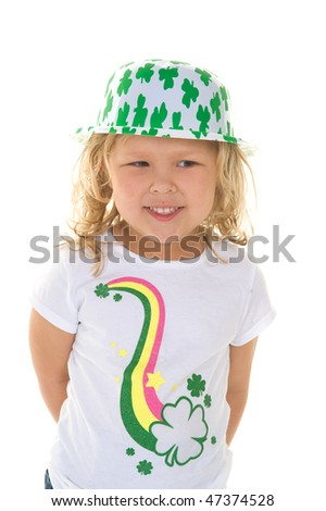 Adorable little blond girl smiling wearing St. Patrick's Day t shirt and hat - stock photo