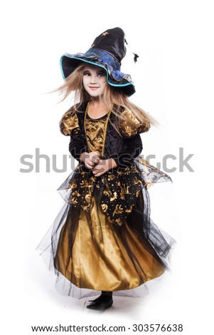 Adorable little blond girl wearing a witch costume smiling at the camera. Halloween. Fairy. Tale. Studio portrait isolated over white background - stock photo