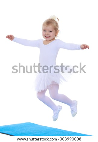 Adorable little blonde girl ballerina in white costumes fun jumping on blue mats spread wide his arms-Isolated on white background - stock photo