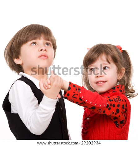 Adorable little boy and girl holding each other hands