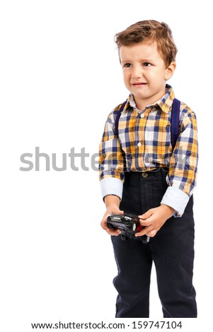 Adorable little boy crying against white background - stock photo