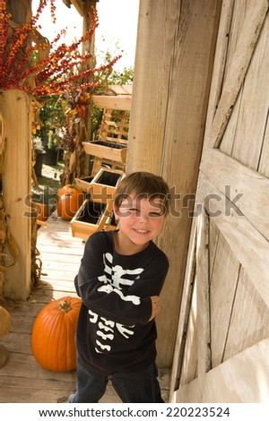 Adorable little boy dressed in skeleton clothes for Halloween  - stock photo