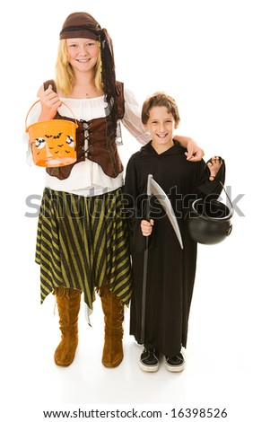 Adorable little boy in halloween costume getting ready to trick or treat with his sister.  Full body isolated on white. - stock photo