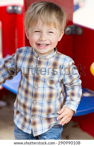 Adorable little boy laughing on the playground. - stock photo