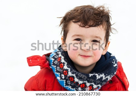 Adorable little boy playing in snow - stock photo