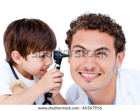 Adorable little boy playing with the doctor at hospital - stock photo