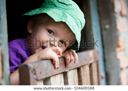 Adorable little boy taken closeup outdoors in summer - stock photo