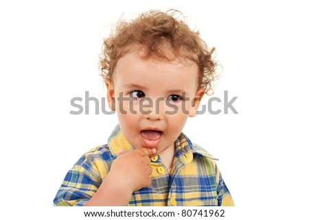 Adorable little boy with his finger near the mouth