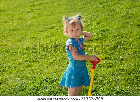Adorable little child girl on grass on meadow. Summer green nature background.  Use it for baby, parenting or love concept - stock photo